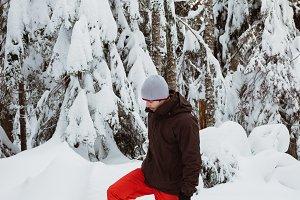 Man in winter wear walking on snowy landscape