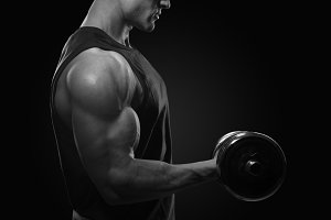 Attractive bodybuilder with dumbbell