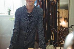 Confidence craftswoman standing in workshop