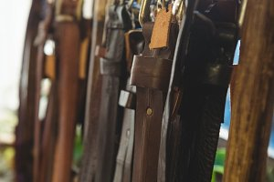 Various leather accessories hanging on hook