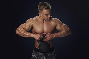 Attractive sportsman in gym