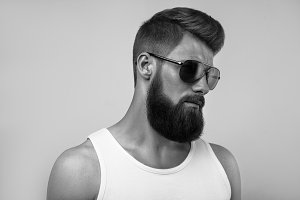 Bearded man portrait on white