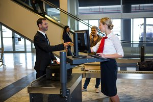 Female staff interacting with passenger