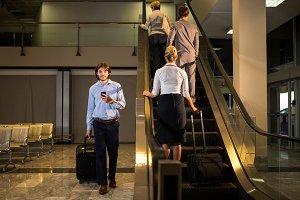 Female staff and passengers on escalator