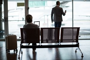 Businesspeople in waiting area at airport terminal