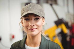 Portrait of female mechanic in repair garage