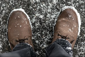 Boots covered with snowflakes,