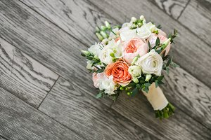Bridal bouquet on the wooden floor