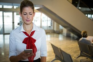 Air hostess using her mobile phone