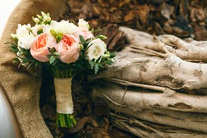 Wedding bouquet on a wooden texture