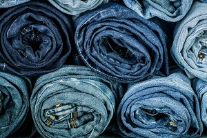bunch of twisted jeans, close-up, fashionable clothes