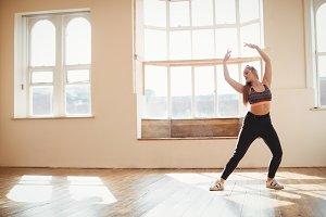 Pretty woman practising hip hop dance