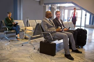 Businessman interacting in waiting area