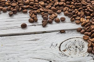 coffee beans on white wooden background, closeup