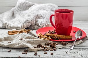 red coffee Cup on a plate, wooden background, beverage, Christmas morning