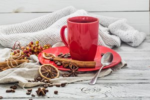 red coffee Cup on a plate