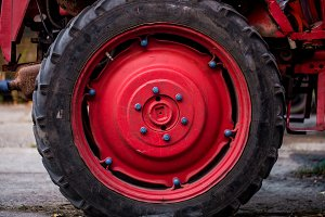 Big red wheel of the tractor