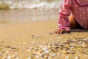 pretty girl crawling on the beach