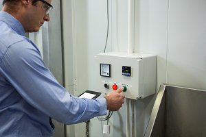 Technician operating machine