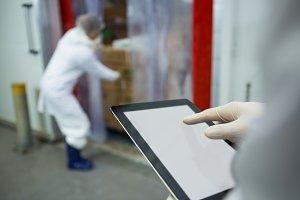 Technician using digital tablet