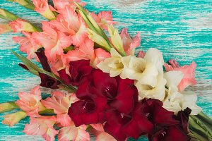 Bouquet of light pink, white and red Gladiolus on the light background