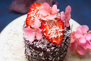 Chocolate cake with strawberry flower decor