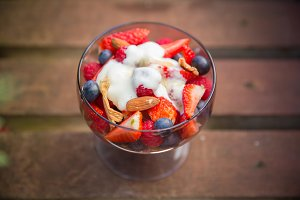Fresh yogurt with fruits and muesli on breakfast