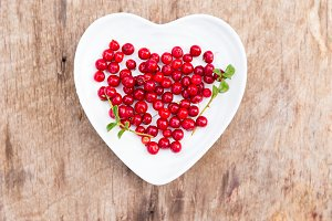 red forest cranberries heart plate wood