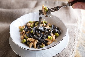 Black ink pasta with chicken and green olives