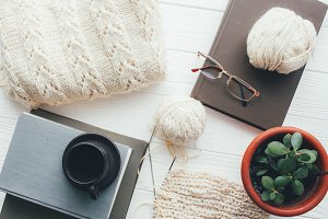 Knitted sweater,ball of yarn,needles