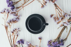 purple flowers and a cup of coffee