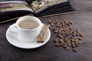 Coffee cup, beans and cinnamon