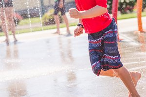 Boy in Red Running at Splash Park