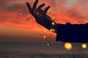 Hand holding lights