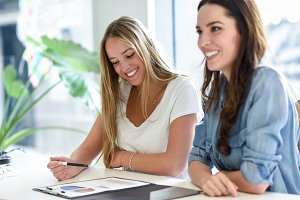 Two girls studyin graphics