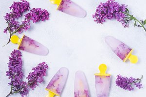 Popsicles with lilac flowers
