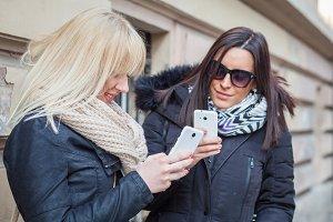 young girls with smart phone