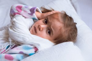 diseased little girl in white bed