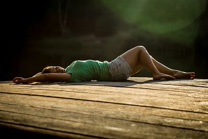 beautiful girl lying on wooden pier