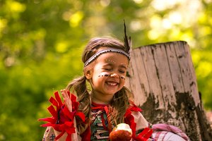 beautiful little girl playing on the nature of the Indians