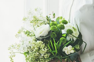 Young woman & white flowers bouquet