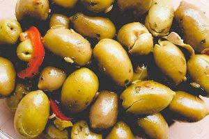 Green olives vegetables background, faded vintage look