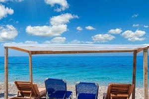 Summer sea beach with sunbeds