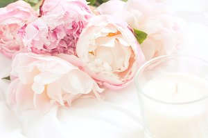 Peonies and candle