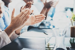 Closeup photo of partners clapping hands after business seminar. Professional education, work meeting, presentation or coaching concept.Horizontal,blurred background.