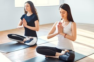 Two womens meditating