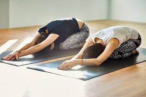 Two young women doing yoga asana