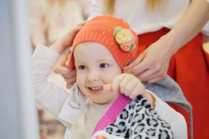 Mom wears daughter's orange cap