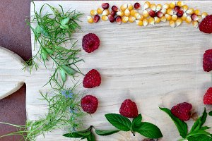 Maize and raspberries on cutboard