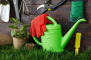 Gardening tools and equipment closeup in the backyard.